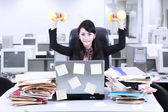 Businesswoman exercise in office — Stock Photo