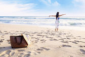 Enjoying freedom at the beach — Stock Photo
