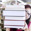 Girl student behind books — Stock Photo