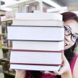 Stock Photo: Girl student behind books