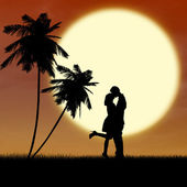 Silhouette kissing by sunset at the beach — Stock Photo