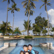 Family vacation in tropical beach — Stock Photo #16976199