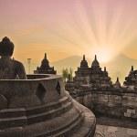 Borobudur temple and buddha statue — Stock Photo #16977017
