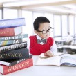 Boy study literature books at library - Stock Photo