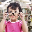 Girl wearing glasses in school - 图库照片