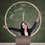 Happy businesswoman winning in 2013 — Stock Photo