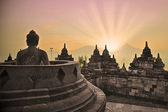 Borobudur temple and buddha statue — Stock Photo
