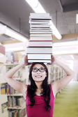 Girl student carry books on head — Stock Photo