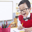 Happy preschooler draw with color pencils — Stock Photo