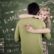 Happy couple hugging in class — Stock Photo #18346259
