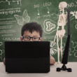 Asian boy studying with laptop — Stockfoto