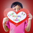 Boy give love card to parents — Stock Photo