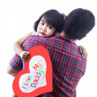 Girl hold love card hug by dad — Stock Photo