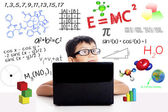 Smart asian boy with laptop — Stock Photo