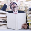 Stress businessman and stack of books — Stock Photo #19028665