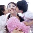 Happy mother kissed by children - isolated — Stock Photo #19029533