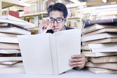 Busy businessman at library — Stock Photo