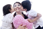 Happy mother kissed by children - isolated — Stock Photo