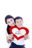 Boy giving love card to mother — Stock Photo