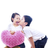 Brother kiss sister on white — Stock Photo