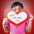 Boy holding valentine card — Stock Photo