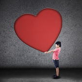 Boy holds big blank heart sign — Stock Photo