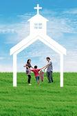 Christian family at church — Stock Photo