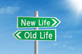 Road sign of new life and old life — Stock Photo