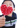 Boy holds love lollipop — Stock Photo #19181347