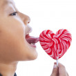 Boy licking love lollipop — Stock Photo #19181391