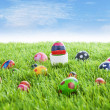 Royalty-Free Stock Photo: Easter eggs on grass horizontal