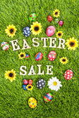 Easter sale eggs on grass vertical — Stock Photo