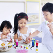 Children painting easter eggs in art class — Stock Photo