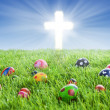 Easter eggs and Cross on grass — Stock Photo #19761885