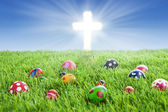 Easter eggs and Cross on grass — Stock Photo