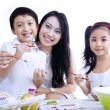Family painting eggs isolated — Stock Photo