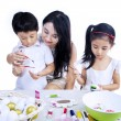 Family having fun painting Easter eggs isolated - Foto de Stock