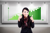Successful business woman with bar chart — Stock Photo