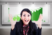 Excited businesswoman with profitable bar chart — Stock Photo