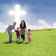 Christian family running in park — Stock Photo #20161787