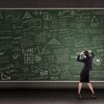 Thinking teacher in front of blackboard — Stock Photo