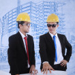 Architect and supervisor review blueprints — Stock Photo