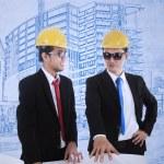 Architect and supervisor review blueprints — Stock Photo
