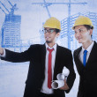 Architect explains blueprint plan — Stock Photo
