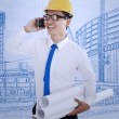 Happy engineer calling friend - Stock Photo