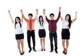Business team raised hands in victory — Stock Photo