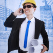 Happy architect calling on successful project - Foto de Stock