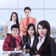 Confident business team in office — Stock Photo #21776239