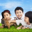 Happy children with puppy — Stock Photo #21931081