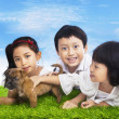Happy children with puppy — Stock Photo